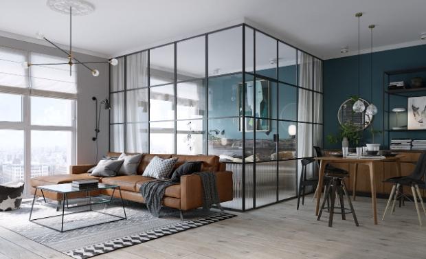 une chambre installée dans une verrière pour ce petit appartement